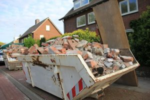 Loaded,Dumpster,Near,A,Construction,Site,,Home,Renovation